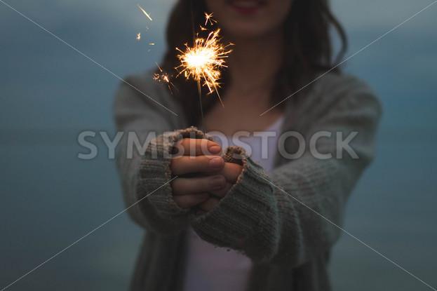 Girl Holding a Sparkler Firework - Symbiostock Express Demo